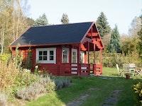 Wolff Finnhaus Gartenhaus Ferienhaus Sauerland A inkl. gratis Fundamentanker/Pads
